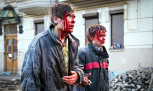 Anti-government protesters are wounded after the clash with the police in Kiev