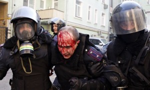 Policeman evacuate a wounded colleague in Kiev